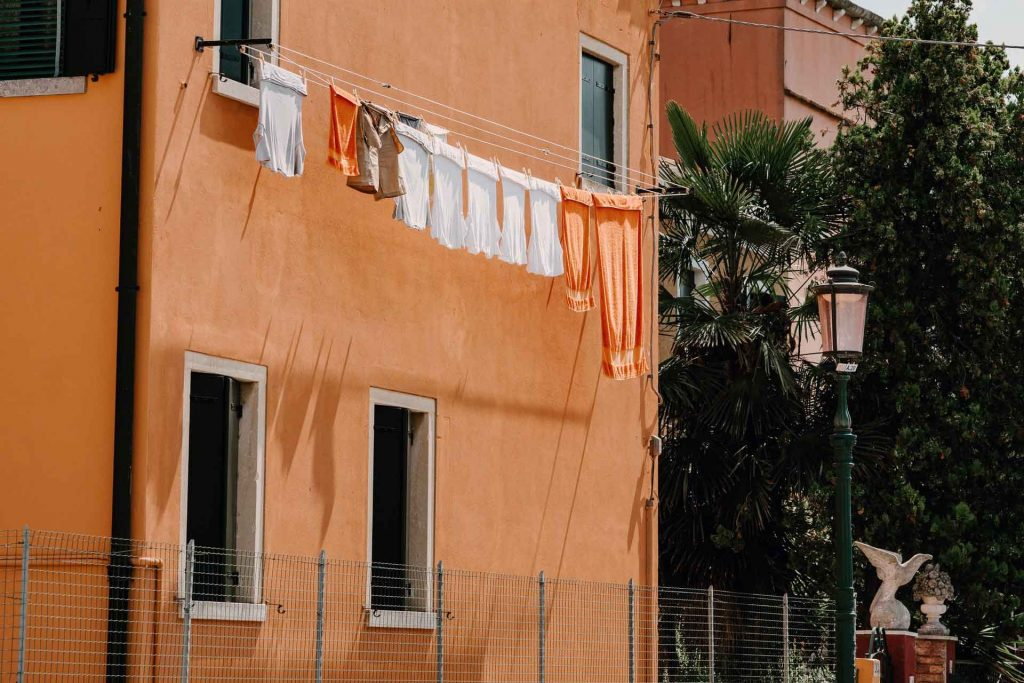 the environmental impact of laundry banner showing clothing drying in air